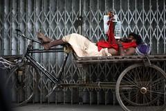 GodChild (N A Y E E M) Tags: vagabond sleep rickshawvan today morning eidaladha footpath pavement street red norahmedroad chittagong bangladesh carwindow