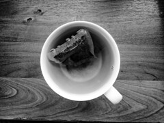 A dissolving (mikeattwerk) Tags: bw texture wood cup tea water mixture