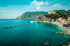 Monterosso (robiferra94) Tags: sky landscape city sea color boat beach travel clouds italy rock beautiful ship seascape hill holiday 5 swimming national park sp liguria mare nuvole barca cinque terre spezia monterosso