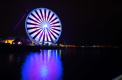 Great Wheell of Seattle (marcuscrockett1999) Tags: seattle downtown light trail trails ferris wheel night color water reflections