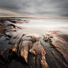 Rock patterns - Bonäsudden (- David Olsson -) Tags: longexposure morning lake seascape nature water clouds sunrise landscape dawn early nikon rocks cloudy sweden patterns tripod may sigma windy cliffs le 1020mm 1020 squarecrop vänern 2012 dx hammarö värmland ndfilter lakescape smoothwater bonäsudden d5000 fiskvik davidolsson räggårdsviken nd500 lightcraftworkshop 2exposuremanualblend minicove