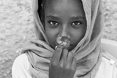 Sudan bw (anthonyasael) Tags: africa portrait people flower girl face childhood horizontal closeup kids scarf children religious person photography one 1 kid war child veil faces head african muslim islam sudan traditional country headscarf central hijab culture east human arab covered portraiture smell only anthony conflict and shoulders tradition khartoum playful ethnicity africans smelling sharia headscarves tchador asael