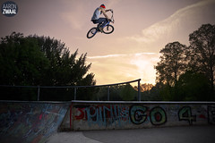 Emile Bouwman boosts over the rail (AaronZwaal) Tags: park sunset cactus nijmegen air zeeland skatepark tanktop 1750 huge 28 tamron airtime emile represent 560 460 v5 goffert goffertpark bouwman 2flashes yongnuo