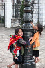 Play time (stevech) Tags: morning red mountain black cold flower color girl women village market traditional hill sunday vietnam buy cai tribe sell minority lao sapa hmong dzao laocai hilltribe bacha