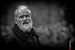 Eyes and Imagination (Jeff Krol) Tags: street old city portrait blackandwhite bw white man film monochrome look canon hair fur beard eos eyes noir dof bokeh ripple candid streetphotography stranger explore passion imagination groningen seen wrinkles facial f28 2012 70200mm grunn 70200l explored ef70200mmf28lusm 60d canon60d img6064 passioned jeffkrol