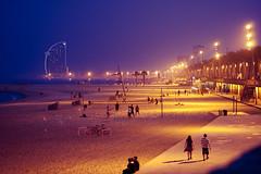 Beach at night (manuel ek) Tags: barcelona light sky people building beach skyline night evening sand natural area boardwalk recreational