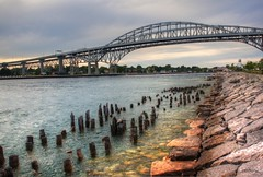 evening at the bridge....... (bonnie5378) Tags: rocks hdr stclairriver bluewaterbridges sarniaontario canadianfemalephotographer ilovemypics photosofqualitytosmileabout june2012 porthuonmichigan
