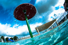 Cooling off at the pool (b.campbell65) Tags: sky sunlight reflection nature mushroom wet water pool clouds fence drops underwater slide scuba diving bluesky spray splash refreshing sunbeam splits lifeguardstand overunder castlehills