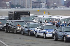 Obama's motorcade awaiting AFO (Tomlin's Images) Tags: boston airport police cadillac runway obama limousine lawenforcement bostonloganairport thebeast motorcade generalmotors bostonharbor bostonpolice massport massachusettsstatepolice