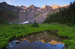 Lower Blue Lake - Mt. Sneffels Wilderness Area (Matt Champlin) Tags: life morning travel camping holiday mountains nature sunrise canon reflections landscape colorado alone glow quiet peace hiking calming tranquility roadtrip calm backpacking huge tranquil towering 2012 sanjuanmountains sneffels mtsneffels lowerbluelakes