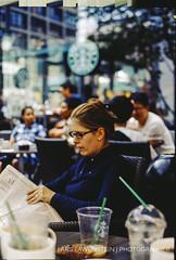 business woman (fabric.softener) Tags: woman berlin film analog 35mm germany 50mm newspaper nikon kodak business starbucks f5 nikonf5 ebx