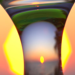 Variations on a sunset #2: Planes of existence (kevin dooley) Tags: sunset orange sun lake cup water glass yellow canon distorted michigan lakemichigan variations detergent distort newbuffalo lakemichigansunset 40d variationsonasunset sunsetvariations