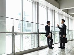 Businessman who talks with subordinate in entrance (emilybostic1) Tags: cooperation unity growth idea preparations
