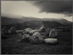 Castlerigg #3 (Firery Broome) Tags: landscape mountains hills clouds sky standingstones stonecircle earlymorning earlyautumn castlerigg scotland historic historicplaces historicicons travel worldtravel olympus olympus2100 photoshop viveza colorefexpro alienskin exposurex blackandwhite blackwhite bw monochrome blackandwhitelandscape blackandwhitenature manmade wildplaces europe greatbritain keswick cumbria sliderssunday 365