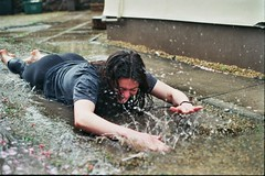 _2A_00055 (annie.stowell) Tags: film filmphotography 35mm portrait water rain puddle summer bristol girl