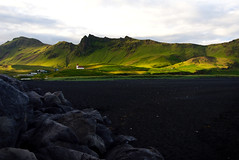 The Vk  Mrdal village among the colorful hills (pawel.suchecki) Tags: hill beach sand black blacksand blackbeach church village vk vkmrdal landscape rock stone sony sigma reynisfjara iceland