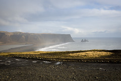 Reynisdrangar from Dyrhlaey (breakbeat) Tags: icelands0295 dyrhlaey southiceland shore sea rock volcanic island iceland landscape winter ocean moss view vkmrdal vk beach black sand mist travel travelphotography lonelyplanet traveltheworld bucketlist