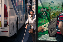 Between two worlds (zilverbat.) Tags: portugal streetphotography candidphotography streetlife streetcandid streetshot scenery straatfotograaf image peopleinthecity people portrait portret photography woman world urbanlife porto zilverbat urban bus canon bokeh dof oldwoman