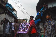 Homeward Ho! (Rajib Singha) Tags: travel street outdoor art idol people festival spiderman interstingness flickriver nikond200 mfnikkor20mmf35aislens kumartuli kolkata westbengal india