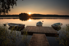 Before the fishermen arrive (helena678) Tags: lake fishing fish jetty boat rowingboats early morning reeds sunrise light trees peaceful serene autumn fall september sweden sverige scandinavia water