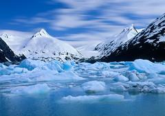 Floating Through the Ages (David Shield Photography) Tags: blue sky lake snow mountains color ice alaska clouds landscape scenic glacier anchorage portageglacier girdwood davidshield