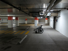 Parking Garage, Capitol Hill, Seattle (Blinking Charlie (away)) Tags: seattle usa parkinggarage wheelchair washingtonstate capitolhill 2012 exposedpipes canonpowershots100 supportcolumns recedingspace blinkingcharlie grouphealthcentralmedicalcenter
