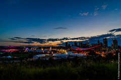 Stampede Grounds (theobjectivesea photography) Tags: longexposure nightphotography sky canada calgary clouds lights nikon saddledome alberta rockymountains stampede calgarytower calgarystampede 100years greatestoutdoorshowonearth downtowncalgary landscapephotography canadianphotographer stampedegrounds adobelightroom d7000 tokinaatx1116mmf28