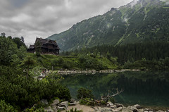 Shelter over the Morskie Oko (wriggler!) Tags: travel mountains water beauty landscape climb nationalpark pond europe day view pentax poland polish climbing shelter cluds zakopane morskieoko wriggler