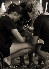 Praying Together (Poocher7(Away until September,sometime)) Tags: prayer trust surrender faith believe jesus comfort encouragement castingburdens friends together agreement god listening hearing expectation peace calm atease monochrome talkingtogod blackandwhite sandals shorts tshirts youth prettygirls sepia outdoors candid portrait people camp reachingout receiving adirondackchairs beach holdinghands