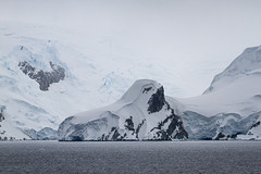 Overburdened with Ice_MG_2999 resized (Robyn Aldridge will get back on track by late next) Tags: antarctica antarcticpeninsula akademikioffe icescape ice icebergs iceberg icefloes island mountains mountain seascape snow shapes sea snowscape shoreline seas summertime seashore rocks ripples beach boulders outdoors nature landscape lrcc light