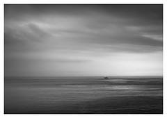 Heading Home (picturedevon.co.uk) Tags: breakwater brixham torbay englishriviera devon seascape sunset blackandwhitephotography fineart monochrome coast sky clouds boat 10stopnd nisi overcast