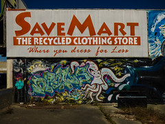 Where You Dress for Less (Steve Taylor (Photography)) Tags: savemart octopus bottle drows drips web cobweb hoarding yopops fromthegroundup art sign graffiti mural streetart happy fun newzealand nz southisland canterbury christchurch