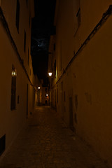 narrow street (magic penguin ^^) Tags: narrow street calle estrecha carrer estret fullmoon moon lluna plena luna llena lights luces llums night nit noche ciutadella menorca illa isla island streetlight sky clouds callejon