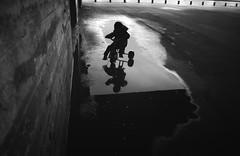 (LaurentBertrais) Tags: enfant nuit saintnazaire streetphotography urbain reflet ombre eau vlo base sous marine