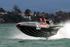 Flying Outboard (Mike Brebner) Tags: autumn sea newzealand sports water sport danger race speed boats harbor boat championship nikon action harbour outdoor offshore may fast racing final nz boating 29 powerboats races powerboat thrills association 2012 tauranga bayofplenty finalround batboat 70300vr offshorepowerboatrace d300s c2012mikebrebner nzopa offshorepowerboatsassociatio outboardpro
