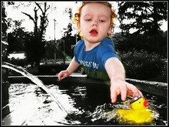 Get back here rubber ducky ....... (delitefulimage) Tags: park summer vacation holiday water fountain playground fun gold duck spring interesting toddler grandchild rubberducky platinum blueribbon delitefulimage mayorschoice