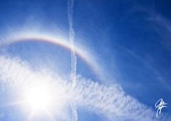 The sun's very own rainbow (jcdriftwood) Tags: sun rainbow glory halo refraction sundog vaportrail colorspectrum gloriole sunrainbow