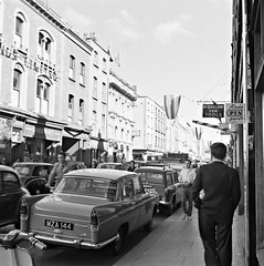 Capel Street, Dublin at 9.30 am (National Library of Ireland on The Commons) Tags: ireland music dublin clock june goodwins pub lounge sunny tools barber tuesday 1960s morrisminor quiff sixties hairdressers kerosene 28th 1960 0930 wolseley varian nearys leinster capelstreet wolseley1560 slatterys playersplease mcquillans nationallibraryofireland brushmanufacturers aladdinpinkparaffin jamespodea mza144 mcquillansfortools pathairstylist slatterysofcapelstreet odeaphotographiccollection