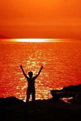 saluto al sole (meghimeg) Tags: light sea woman sun sunrise donna mare alba explore sole gim luce 2012 bordighera ginnastica