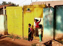 Kampala Street Kids (cowyeow) Tags: poverty africa road street old sign shop store funny african poor shed shack uganda kampala funnyafrica
