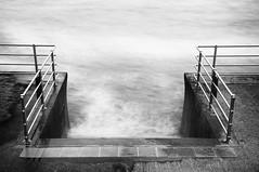 Steps into the sea (Abgnfcl13) Tags: uk longexposure white mist black beach water metal stone swansea wales stairs concrete nikon waves tide steps unknown splash saltwater hightide swanseabay flooddefences d7000