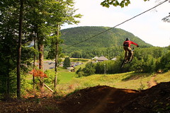 pat,mt sugarloaf (theLionel411) Tags: trees mountain green bike crazy high air fast drop dirt trail biking sugarloaf far bail campbellton hangtime nbphoto overshoot