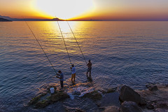 Fishermen (Theophilos) Tags: sunset sea sky rocks fishermen crete rethymno