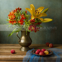 Still life with flowers and lychee fruit (Xaomena) Tags: wood old blue stilllife orange flower fruit vintage table lily antique fineart decoration tasty plate retro celebration delicious jug vase aged bouquet pitcher alstroemeria gauze lychee bunchofflowers greenbackground