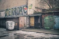 terror (realnasty) Tags: urban city street lodz poland skid row terror danger door trash courtyard backyard dustbin snow brick neglected den microfourthirds m43 mft prime olympus omd gloomy