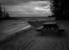 Bench in Honkaniemi (markorsr) Tags: 645 blackandwhite bw honkaniemi m645 mamiya mamiyam645 mediumformat monochrome storm bench beach sand lake water inland joensuu finland