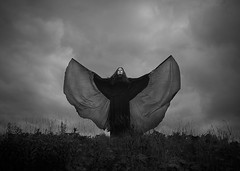 Black Wings (Maren Klemp) Tags: fineartphotography fineartphotographer darkart darkartphotography blackandwhite monochrome sky clouds selfportrait portrait dreamy painterly fineart symbolic evocative ethereal timeless wings nature naturallight outdoors surreal conceptual movement flying dramatic