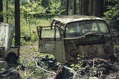 On location (Kriegaffe 9) Tags: vw bus camper rusty abandoned woods trees 50mm wreck