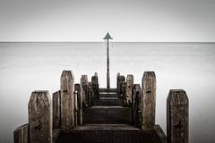 Jetty (dolbinator1000) Tags: aberystwyth ceredigion wales uk coast coastal sea water ocean long exposure wood wooden jetty blur pole horizon