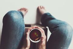 Her cup of tea (ErlandG) Tags: cup feet hands holding hotdrink jeans mint tea teabag warm woman